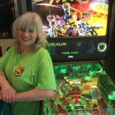 julie gray with pinball machine
